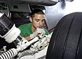 US Navy 041117-N-7816R-012 Aviation Structural Mechanic 3rd Class Jimenez Jorge of Houston, Texas, paints the landing gear assembly on an F-A-18E Super Hornet.jpg