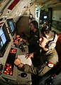 US Navy 041231-N-3122S-001 Aviation Warfare Systems Operators monitor the acoustic station during the flight of a P-3C Orion.jpg