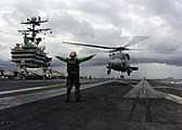 US Navy 050105-N-6817C-072 A Landing Signals Enlisted directs an SH-60F Seahawk to a safe landing aboard USS Abraham Lincoln (CVN 72).jpg