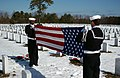 US Navy 050222-N-0020T-013 Boatswain's Mate 3rd Class Marcus Allen and Gunner's Mate Seaman Scott Favara perform flag folding honors for a funeral service held at the Calverton National Cemetery in Long Island, N.Y.jpg