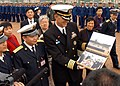 US Navy 050330-N-4702D-012 Commanding Officer, USS Blue Ridge (LCC 19), Capt. J. Stephen Maynard, accepts a scrapbook documenting the ship's port visit to Zhanjiang, China.jpg