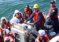 US Navy 050430-N-5526M-035 Sailors transfer men and women in a rigid hull inflatable boat after their boat, a fishing vessel, capsized 25 miles off the coast of Somalia.jpg