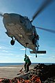 US Navy 050618-N-5781F-093 Supply Department personnel attach a cargo pendant to an MH-60S Seahawk helicopter, assigned to Helicopter Sea Combat Squadron Two Five (HCS-25), during a vertical replenishment.jpg