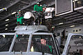 US Navy 050626-N-9551Z-083 Sailors from Helicopter Antisubmarine Squadron One Four (HS-14) conducts a rotor head inspection on an SH-60F Seahawk in the hangar bay aboard USS Kitty Hawk (CV 63).jpg