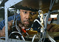 US Navy 050727-N-7568S-001 Aviation Electrician's Mate Airman Apprentice Justin W. Walker checks resistance on a circuit card for a S-3B Viking aircraft electronic control assembly.jpg
