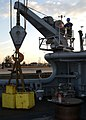 US Navy 050906-N-0535P-078 U.S. Navy Sailors aboard the rescue and salvage ship USS Grapple (ARS 53), perform weight tests for Navy diver davits and booms.jpg