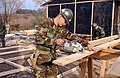 US Navy 060120-F-4462M-029 U.S. Navy Seabees assigned to Naval Mobile Construction Battalion Four (NMCB-4)) build a temporary school in the mountains near Muzaffarabad, Pakistan.jpg