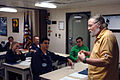 US Navy 060413-N-0555B-060 Naval College Program for Afloat College Education (NCPACE) instructor Sam Taylor teaches a U.S. History class aboard USS Ronald Reagan (CVN 76).jpg