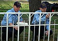 US Navy 070207-N-0577G-002 Fire Controlman 1st Class David Helmer and Fire Controlman 3rd Class Frederick J. Romero, assigned to USS The Sullivans (DDG 68), paint a fence as part of a community relations (COMREL) visit to a kin.jpg