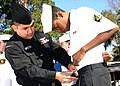 US Navy 070217-N-8544C-006 Hospital Corpsman 3rd Class Mario Amaro, assigned to Patron Squadron Forty Five (VP-45), prepares a Sea Cadet for a uniform inspection during their monthly drill weekend held at Naval Air Station, Jac.jpg