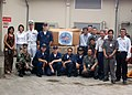 US Navy 070309-N-5013K-316 USS Blue Ridge (LCC 19) Commanding Officer Capt. Jeff Bartkoski poses with Sailors and heads of relief organizations in Indonesia during a turnover of donated Project Handclasp supplies.jpg