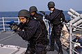 US Navy 071118-N-0167B-081 Members of the security force aboard the guided-missile cruiser USS Shiloh (CG 67) secure the ship's boat deck during a visit, board, search, and seizure (VBSS) drill.jpg