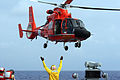 US Navy 071130-N-1008D-005 Boatswain Mate 3rd Class David Burley directs a Coast Guard HH-65A from Honolulu, Hawaii Sector 13, aboard the guided-missile destroyer USS Russell (DDG 59), during a friends and family cruise to Maui.jpg