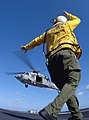 US Navy 080205-N-2838C-010 An Aviation Boatswain's Mate (Handler) directs an MH-60S Seahawk, assigned to the.jpg