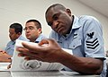 US Navy 080205-N-9758L-023 Religious Program Specialist 1st Class Rubert Cleridor, assigned to Naval Submarine Support Center Pearl Harbor, reads the 2008-09 voting assistance guide during a Federal Voting Assistance Program wo.jpg