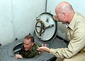 US Navy 080727-N-9493W-125 Capt. Neil Parrott directs General Walter Natynczyk, Canadian chief of Defense Staff, through a scuttle.jpg