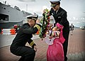 US Navy 090305-N-3830J-031 Capt. Thom W. Burke, left, commanding officer of the amphibious command ship USS Blue Ridge (LCC 19), receives a flower wreath from the daughter of a Republic of Korea naval officer.jpg