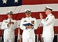 US Navy 090410-N-2728S-008 apt. R. B. Sorenson, center, outgoing commanding officer of Naval Health Clinic Corpus Christi, pauses during applause from Rear Adm. Bob Kiser.jpg