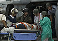 US Navy 090830-N-5253W-099 A naval air crewman assigned to Sea Combat Helicopter Squadron (HSC) 25 assists Japanese service members and nurses from the Japan Self-Defense Force Central Hospital.jpg