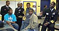US Navy 091028-N-0437M-065 Vice Adm. Anthony L. Winns, right, the Navy Inspector General, speaks with students at Neal F. Simeon Career Academy in Chicago during the Principal for a Day program.jpg