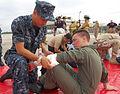 US Navy 091029-N-9402B-001 Hospital Corpsman Mariano Indalecio bandages Naval Aircrewman 1st Class John Holems during an emergency drill.jpg