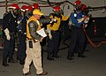 US Navy 091202-N-9116S-039 Chief Aviation Boatswain's Mate (Handler) John P. Pellerito instructs Sailors during a hangar bay fire drill.jpg