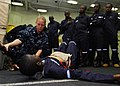 US Navy 100412-N-6138K-315 Hospital Corpsman 2nd Class Jessica Toothe demonstrates how to dress an abdominal wound to a group of embarked Sailors from Gambia, Liberia, Senegal, Sierra Leone, Tanzania, and Togo.jpg