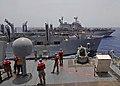 US Navy 100604-N-1082Z-031 Sailors and Marines handle lines aboard the amphibious dock landing ship USS Ashland (LSD 48).jpg