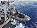 US Navy 101013-N-XXXXH-001 Sailors aboard the guided-missile cruiser USS Leyte Gulf (CG 55) conduct rigid-hull inflatable boat operations.jpg