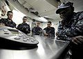 US Navy 101224-N-8824M-098 Sailors aboard the aircraft carrier USS Abraham Lincoln (CVN 72) gather around a telephone speaker for a holiday phone c.jpg