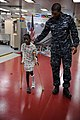 US Navy 110417-F-NJ219-278 Hospital Corpsman 3rd Class Lamonte Hammond steadies a Jamaican boy learning to use his crutches after undergoing surger.jpg
