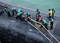 US Navy 110520-N-GE301-049 Sailors assigned to the Los Angeles-class fast attack submarine USS Hampton (SSN 767) handle lines as the submarine deta.jpg