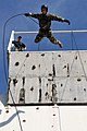 US Navy 110720-N-WW409-534 Lt. Ryan Ramsden, assigned to Explosive Ordnance Disposal Mobile Unit 5, rappels off a tower while training with members.jpg