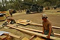 US Navy 110923-N-SM578-009 Seabees assigned to Naval Mobile Construction Battalion (NMCB) 40, Bravo Company, cut lumber for building projects durin.jpg