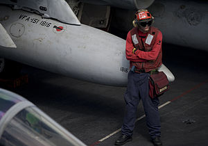 US Navy 111228-N-JN664-139 A Sailor stands by during flight operations aboard the Nimitz-class aircraft carrier USS Abraham Lincoln (CVN 72).jpg