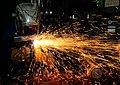 US Navy 120209-N-SK590-014 ull Maintenance Technician 2nd Class Ben Vigness welds scrap metal aboard the Nimitz-class aircraft carrier USS Abraham.jpg