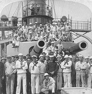 USS Iowa (BB-4) - Crewmen pose under the gun turrets of Iowa in 1898