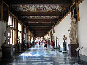 Giovio Series - The First Corridor in the Uffizi. The Giovio portraits are the smaller paintings displayed just below the painted ceiling.