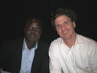 Everything That Happens Will Happen Today - The story of ValentinoAchakDeng (left)—as told by DaveEggers (right) in the book WhatIstheWhat: The Autobiography of ValentinoAchakDeng—inspired Byrne to write hopeful lyrics.