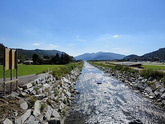 Agno, Ticino - Vedeggio river at Agno. The river bed correction in 1906 opened new farm land in Agno