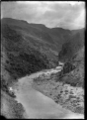 View of a railway line winding along the hills above the Taieri River, circa 1926 ATLIB 311897.png