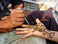 Visitor (Griselda Ramirez) Receives Henna Hand Painting - Shimla - Himachal Pradesh - India (26500852686).jpg