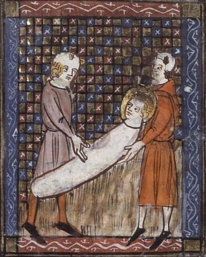 Vitalis of Milan - The martyrdom of Saint Vitalis.  This 14th-century French manuscript depicts Vitalis being buried alive.