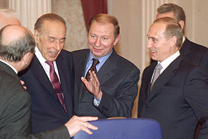 Leonid Kuchma - President Vladimir Putin with Leonid Kuchma, in the centre, and Azeri President Heydar Aliyev before an expanded meeting of the CIS Council of Heads of State.