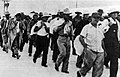 Wake civilian contractors marching in captivity 1941.jpg