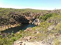 Waterfall in Distance in Edith Falls, Nitmiluk National Park, Katherine, Northern Territory, Australia, during Dry Season.jpg