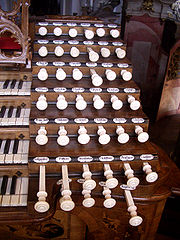 Stop knobs of the Baroque Gabler organ in Weingarten, Germany. The names are visible above the knobs, rather than engraved onto them.