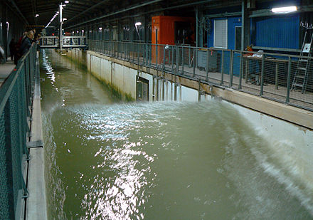 A large wave flume of Forschungszentrum Kuste in Marienwerder/Hannover, Germany, with a length of 307 m and a depth of 7 m. Wellenkanal Marienwerder Monsterwelle.jpg