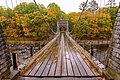 Wire Suspension Bridge, built ca. 1842 near New Portland, Maine, showing one-lane wooden roadway.jpg