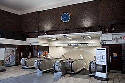 WoodGreen - Escalator and clock after (4570519985).jpg